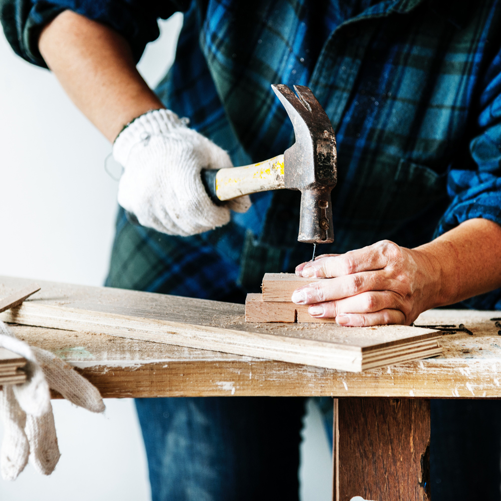 image showing a hammer hitting a nail