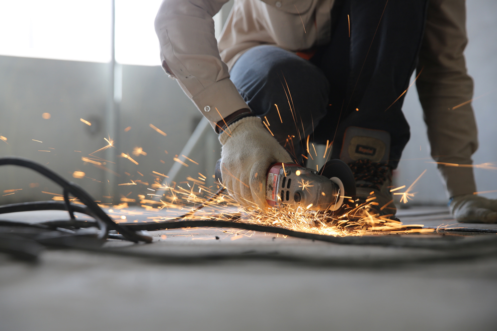 image showing a hand held grinder sparking